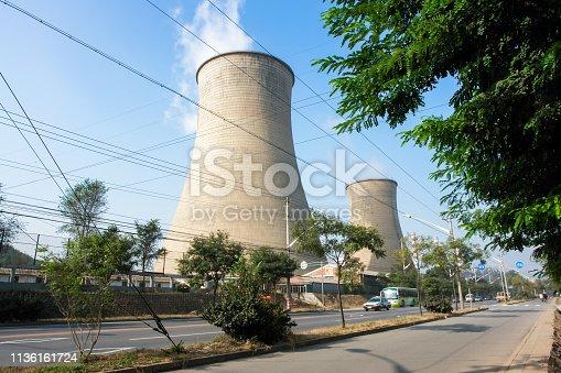 istock Power plant chimney 1136161724