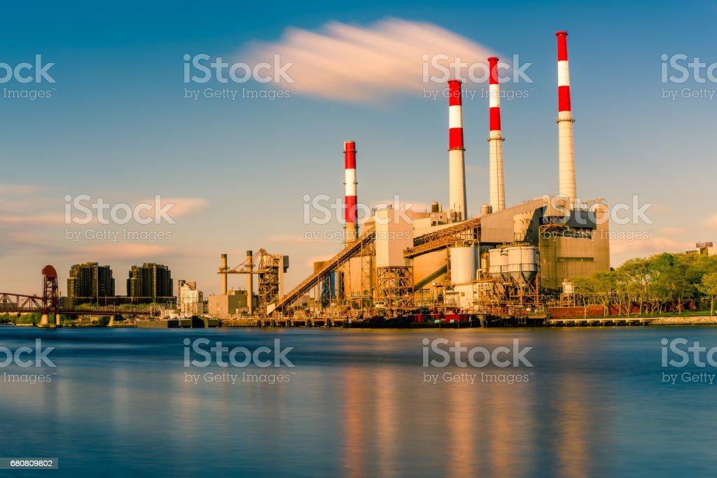 A power plant near a river stock photo