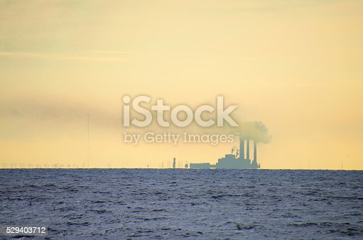 istock Power plant near the water heavily polluting the air pollution 529403712