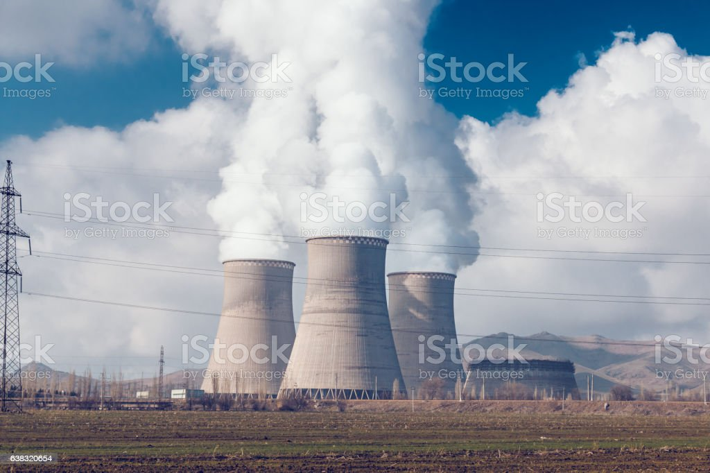 Power plant pipes with smoke stock photo