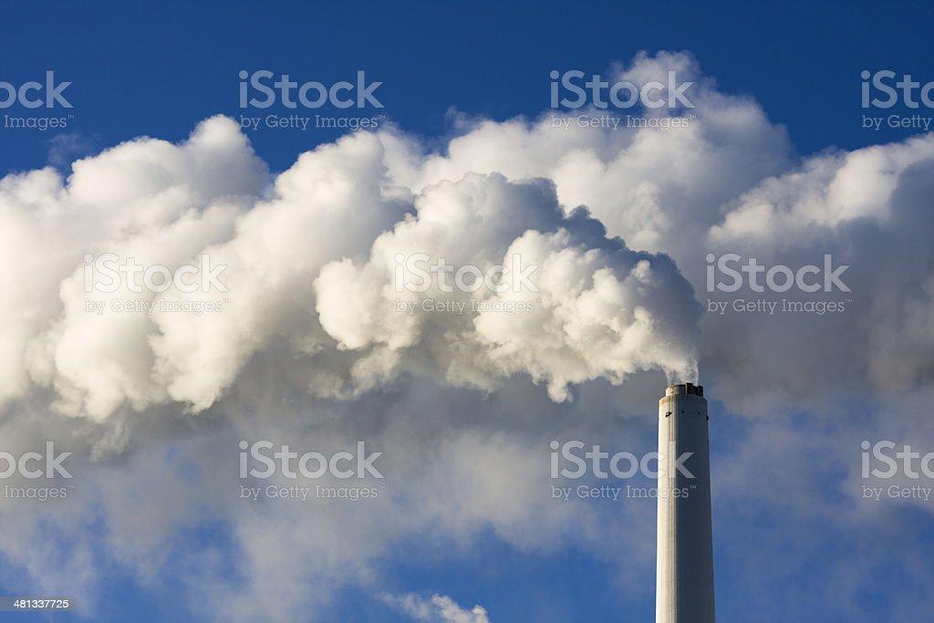 Power plant. Pollution, Smoke. Polarized blue sky. royalty-free stock photo
