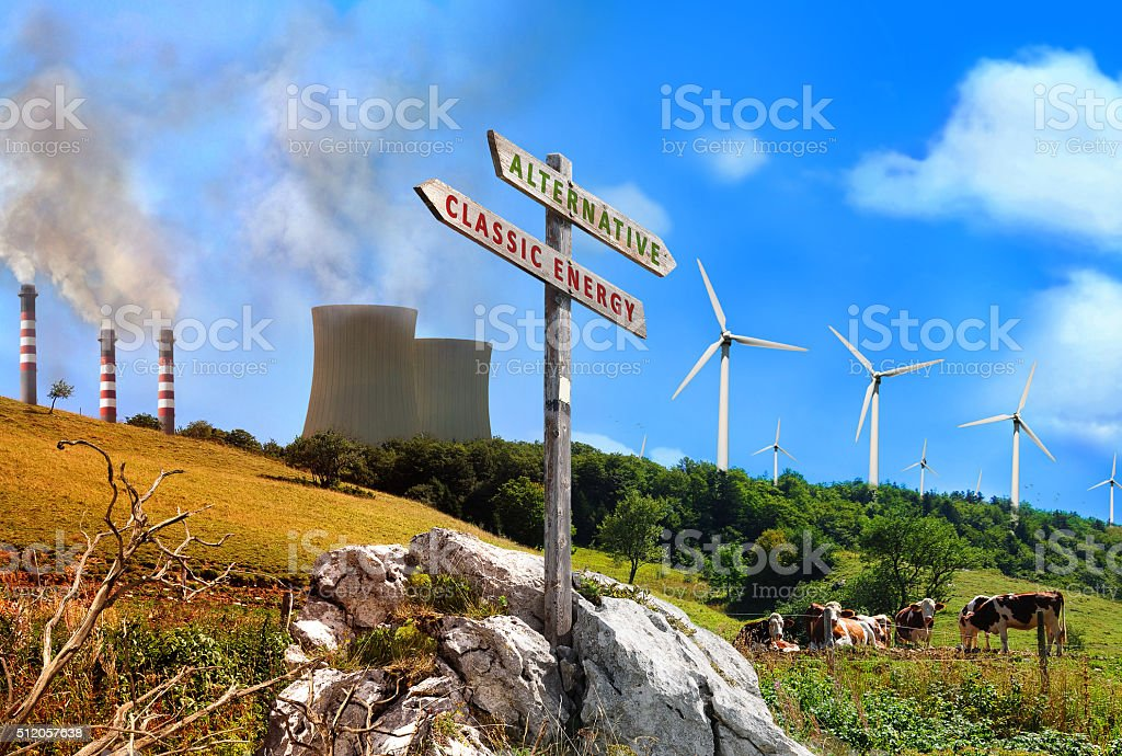 Power plant renewable vs factories classic with sign written stock photo