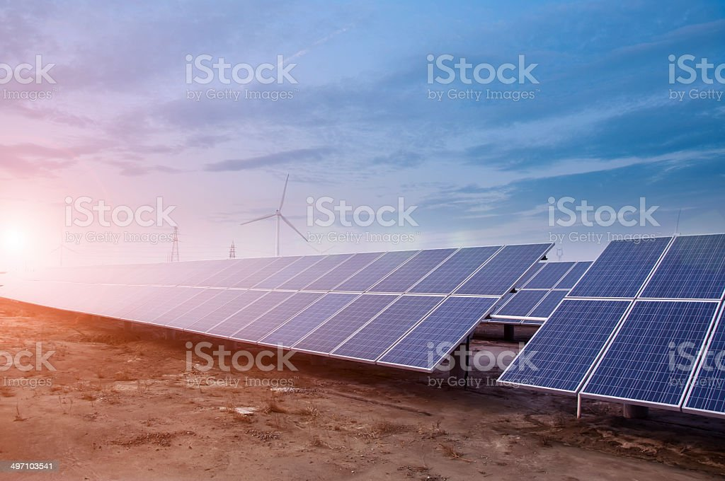 Power plant using renewable solar energy with sun stock photo