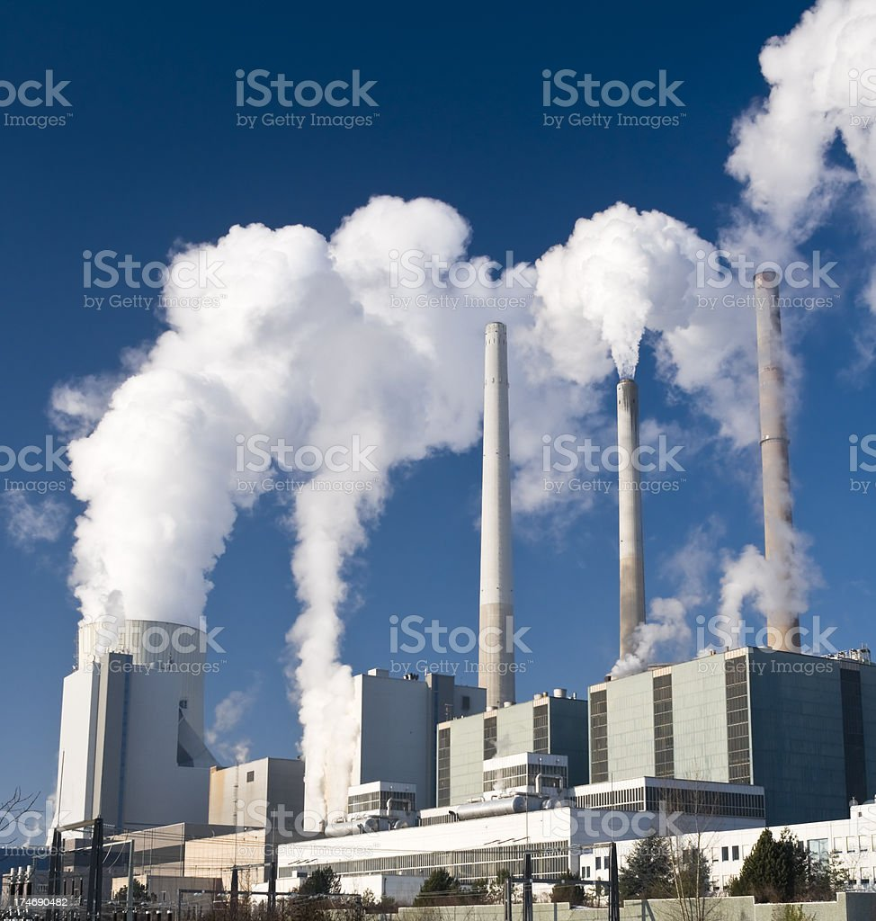 Power plant with dark blue sky stock photo
