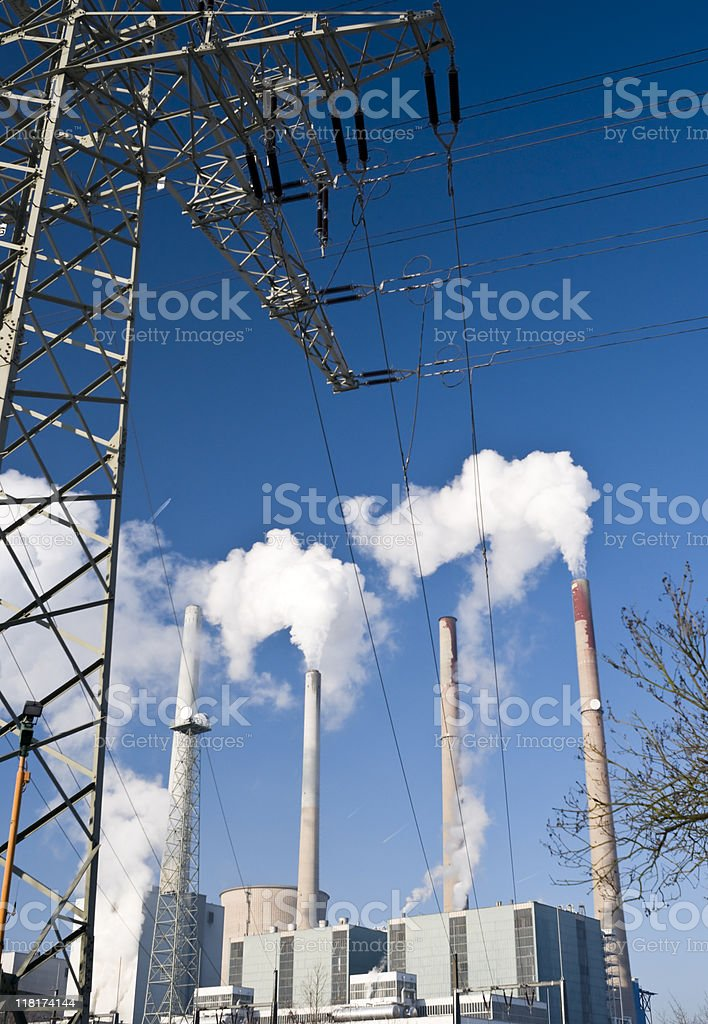 Power plant with steaming chimneys and dak blue sky royalty-free stock photo