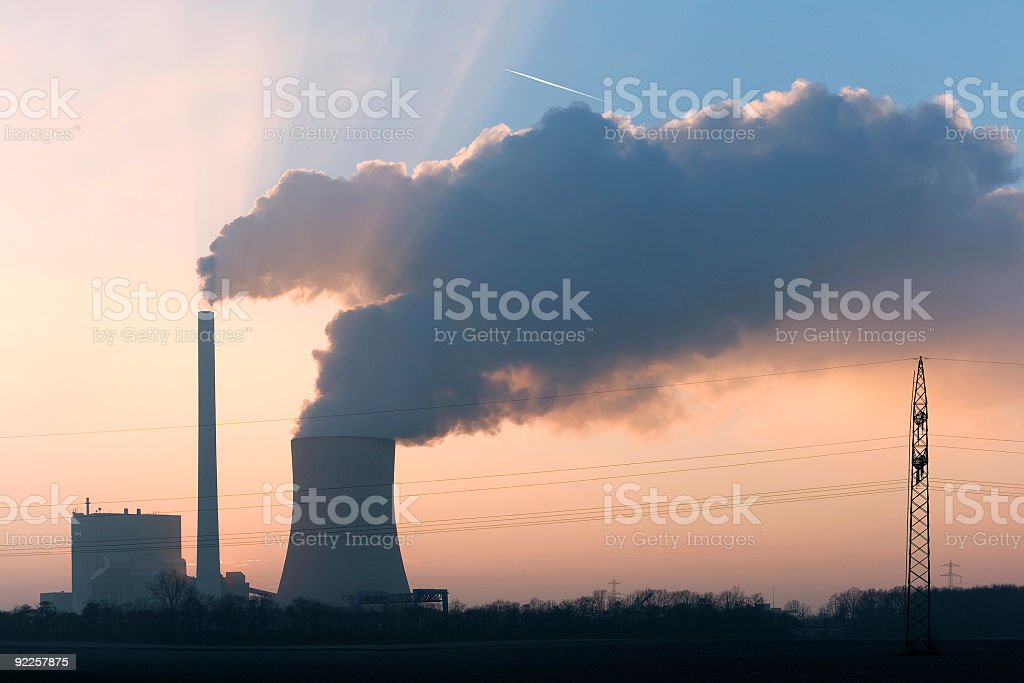 Power plant with steaming cooling tower at sunset - Royalty-free Air Pollution Stock Photo