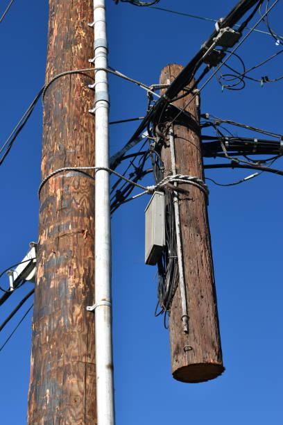 power pole cut both ways - steven harrie stock photos and pictures