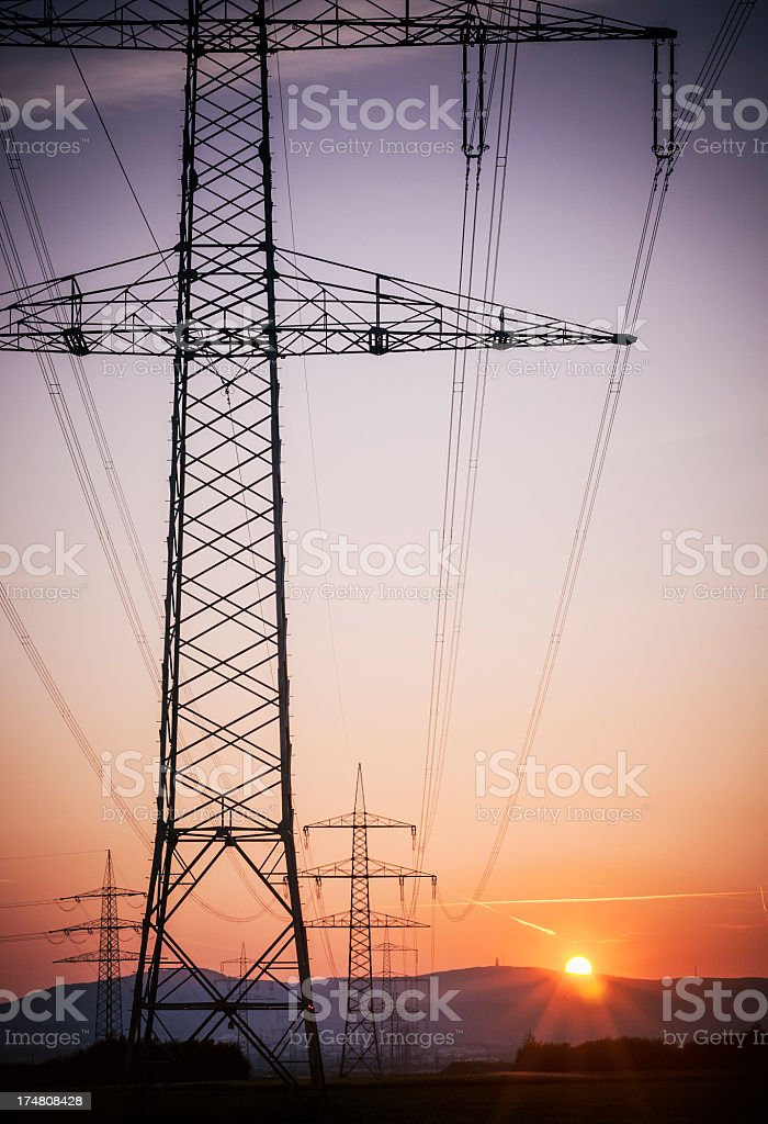 Power pole silhouette at sunset royalty-free stock photo
