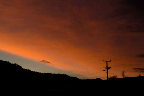Power Pole Silhouette in Front of Sunset Cloud
