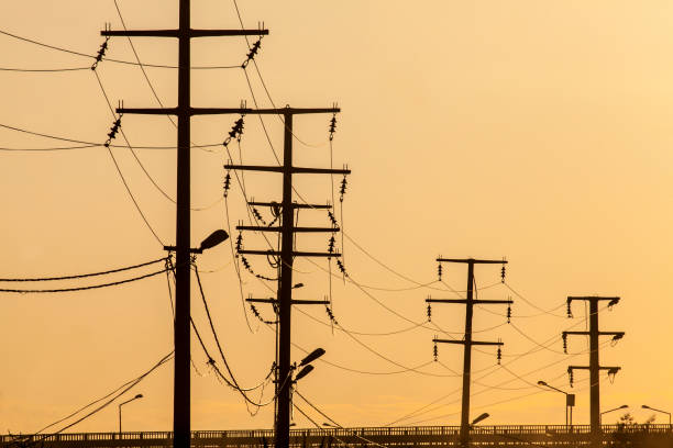 power poles and wires yellow sky and electrical wires power line stock pictures, royalty-free photos & images