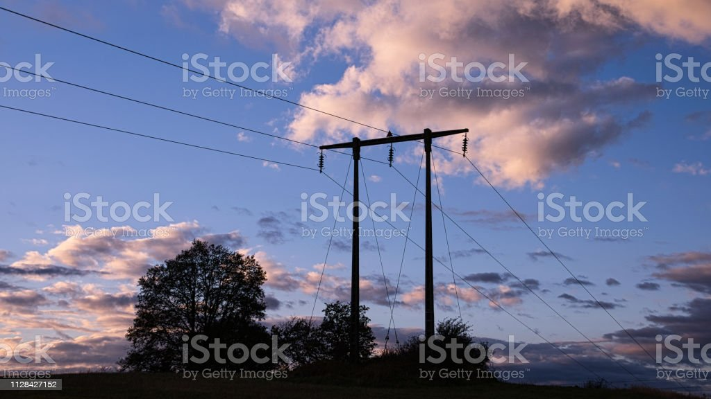 Power pylon at evening stock photo