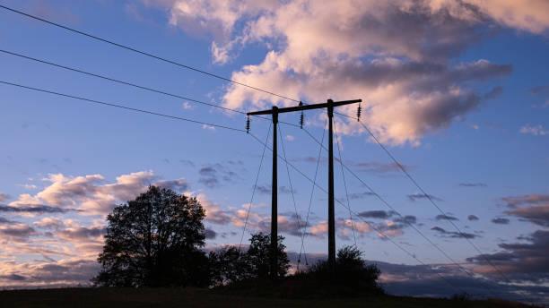 Power pylon at evening stock photo
