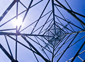 Inside of a power pylon and look into the sun