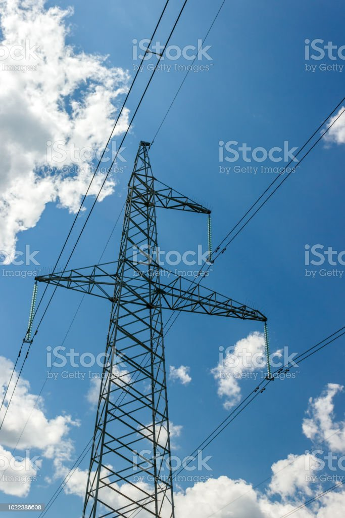 Power pylons and high-voltage lines against the background of the...