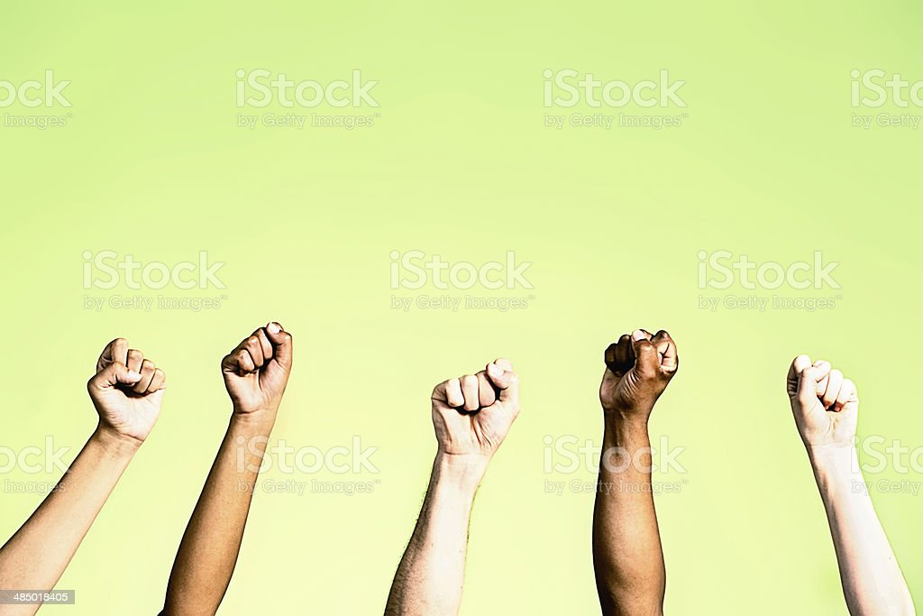 Power salute from group with clenched fists on green royalty-free stock photo