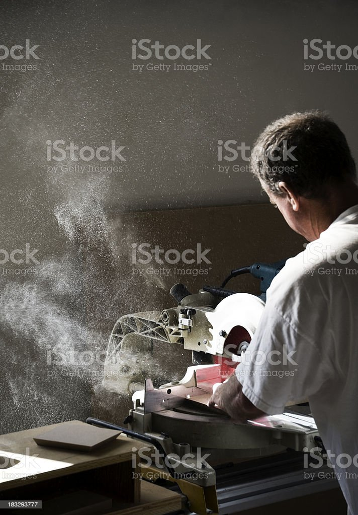 power saw and sawdust stock photo