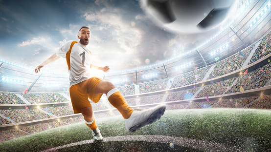 Power soccer kick. A soccer player kicks the ball in stadium. Professional soccer player in action. Wide angle. 3d. Sport
