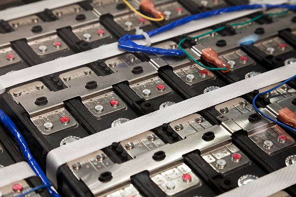 Power Source: Electric Vehicle A closeup of an array of batteries inside an electric car. hybrid vehicle stock pictures, royalty-free photos & images