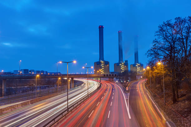 power station and highway at dawn - cogeneration plant stock photos and pictures