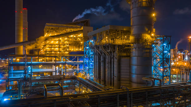 power station, combined heat power plant at night, large combined cycle power plant. - factory imagens e fotografias de stock
