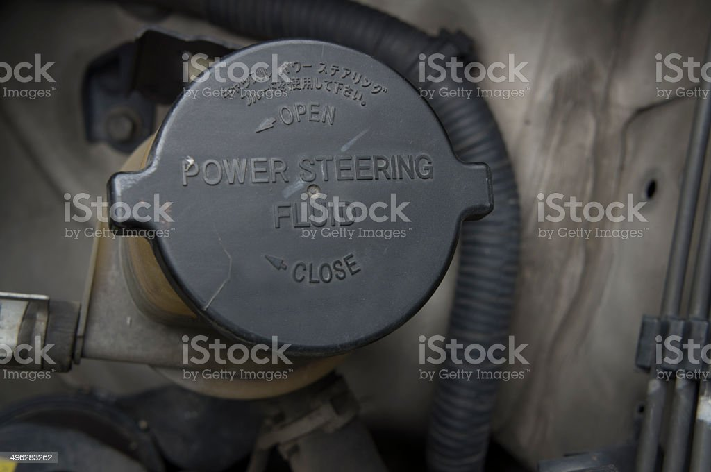 power steering bottle fluid car automobile concept royalty-free stock photo