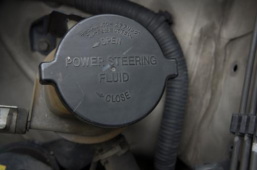 Power Steering Bottle Fluid Car Automobile Concept Stock Photo - Download Image Now