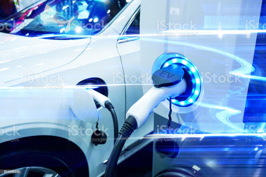 Power supply connect to electric vehicle for charge to the battery. Charging technology industry transport which are the futuristic of the Automobile. EV fuel Plug in hybrid car. stock photo