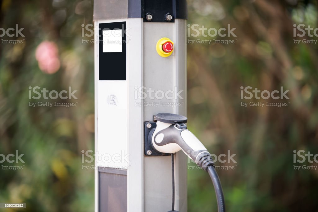Power supply for electric car charging. Electric car charging station.Blurred Background stock photo