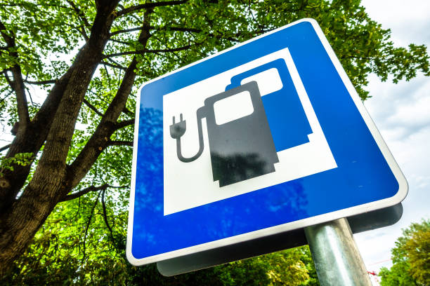 power supply for electric cars signs for a power supply for electric cars in germany electric vehicle charging station stock pictures, royalty-free photos & images