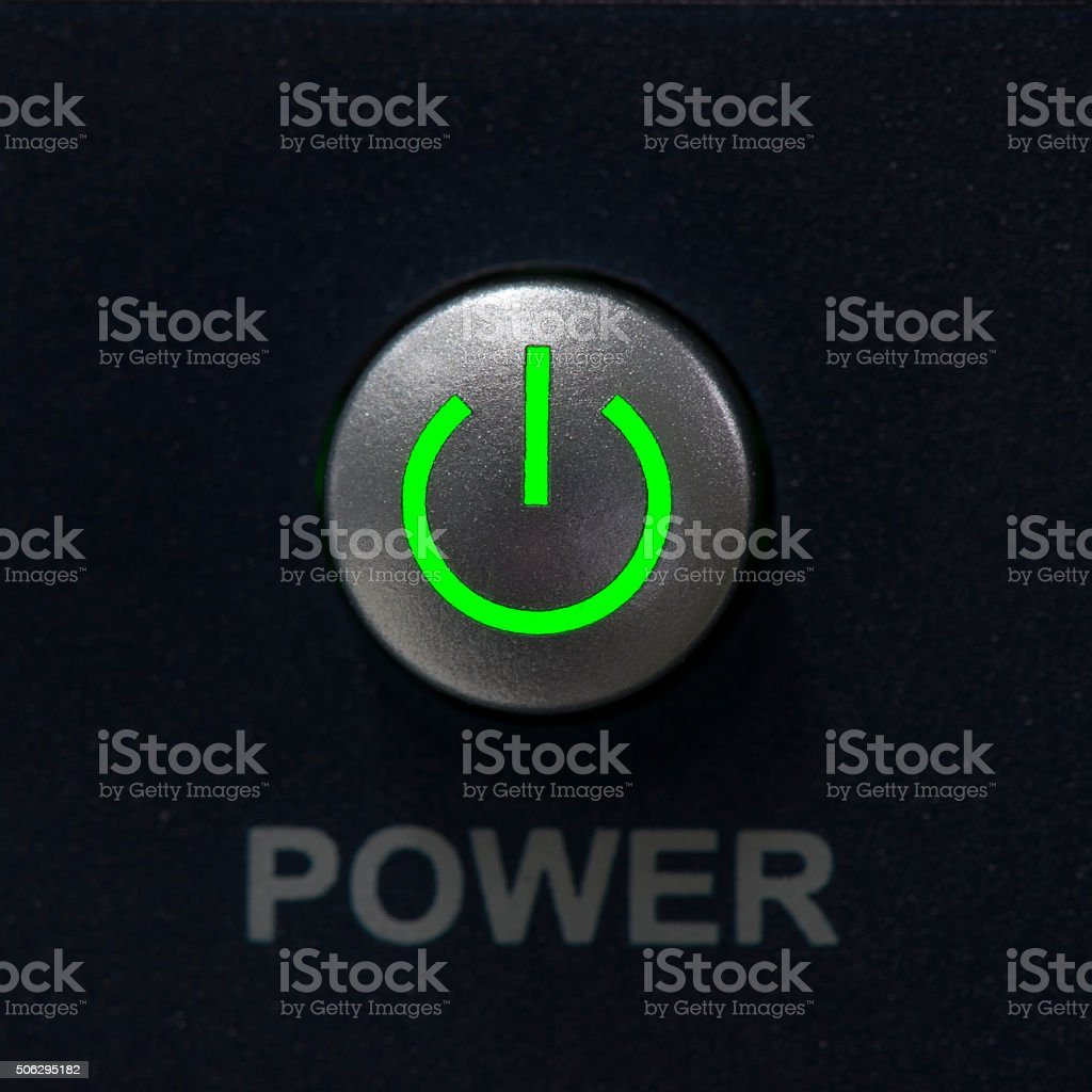 Power switch push button and green light power symbol. stock photo