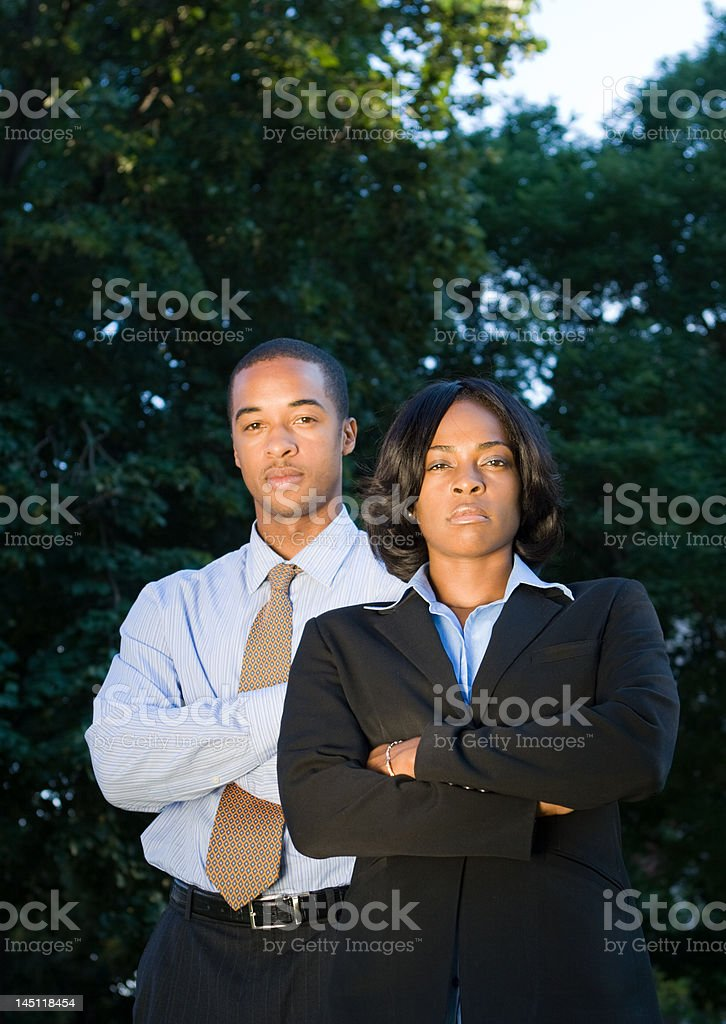 Power Team, Two Serious African American Business People, Arms Crossed stock photo