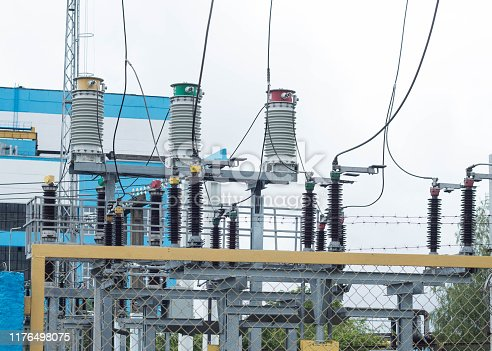 Power transformer in high voltage switchyard in modern electric substation, power station, energy