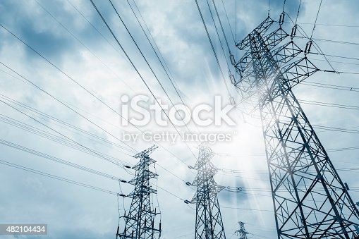power transmission tower against blue sky at dusk