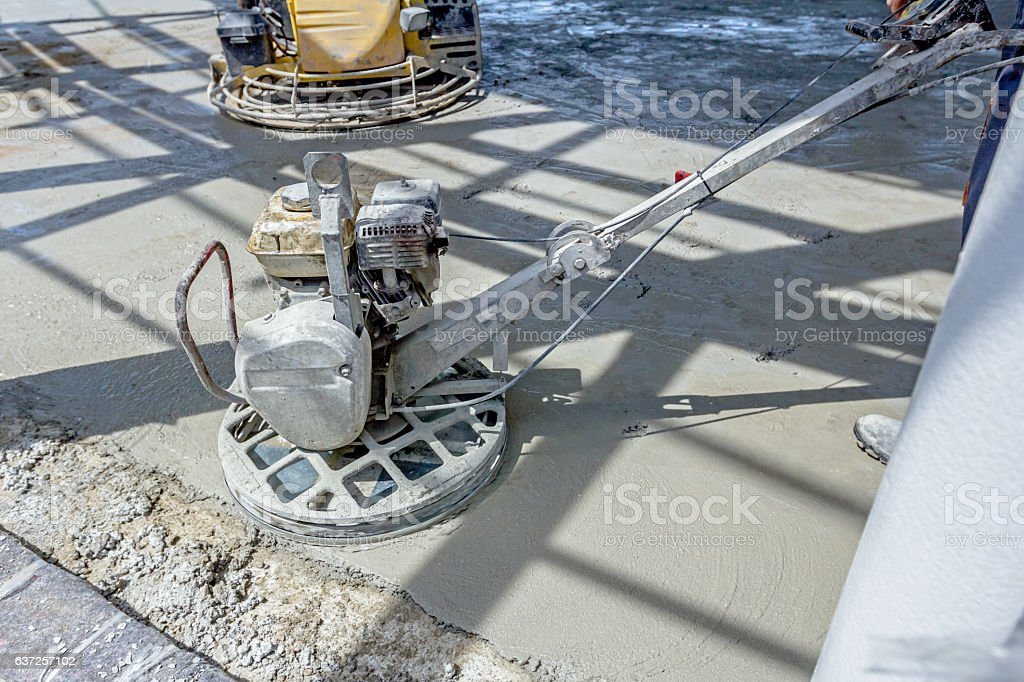 Power trowel machine for finishing surface concrete leveling aft stock photo