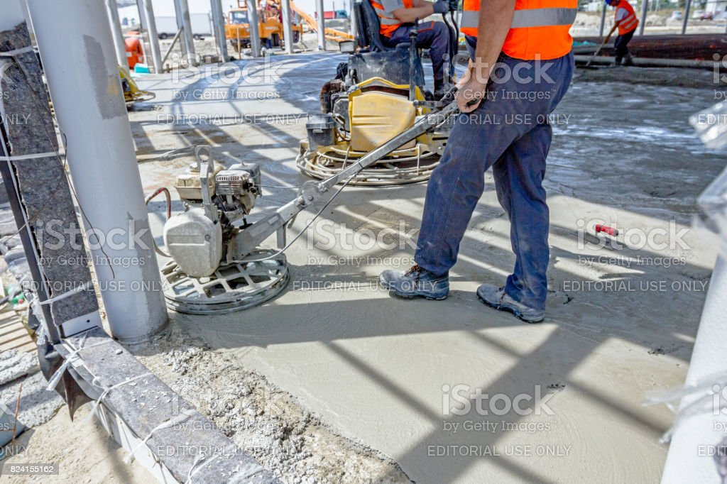 Power trowel machine for finishing surface concrete leveling after pouring stock photo