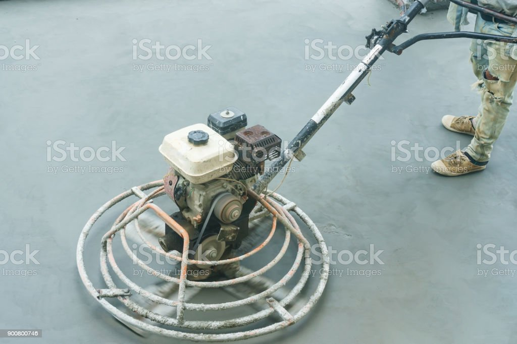 Power trowel machine for smoothing surface to finish of concrete slab floor work step of the building construction. Construction work concept. stock photo