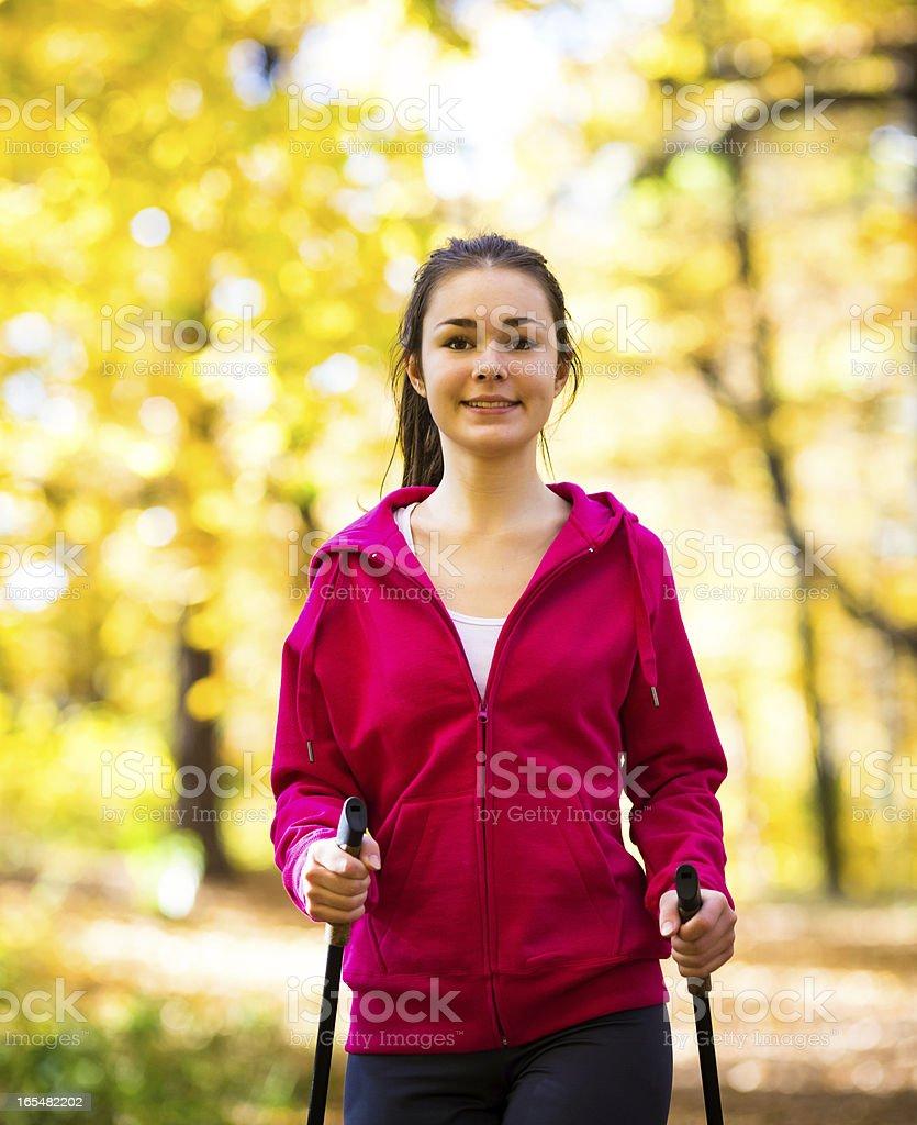 Power walking - girl exercising outdoor royalty-free stock photo