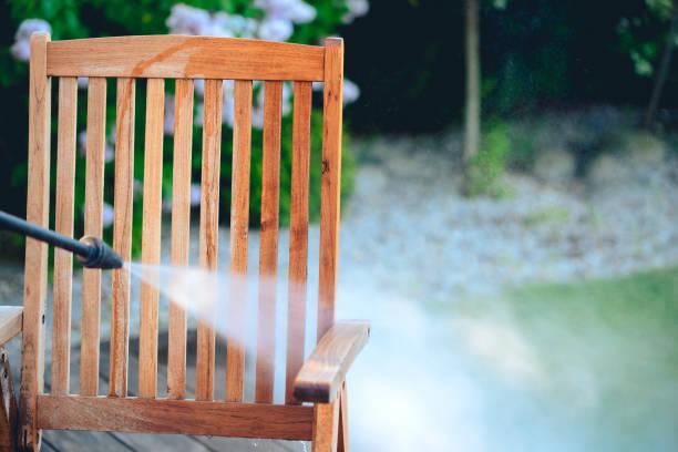 power washing garden furniture - made of exotic wood stock photo