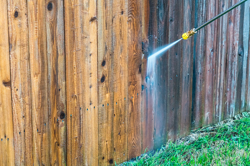 Half Clean and Half Old - Power Washing Wooden Fence
