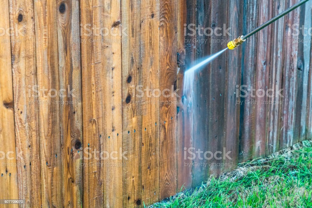 Power Washing Wooden Fence stock photo