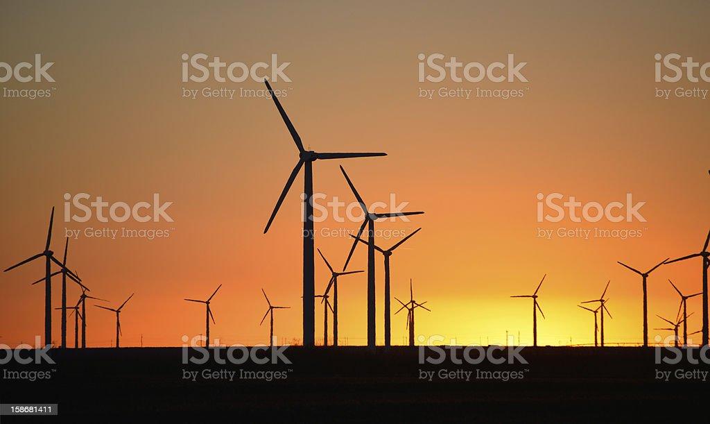 Power windmills at sunset stock photo