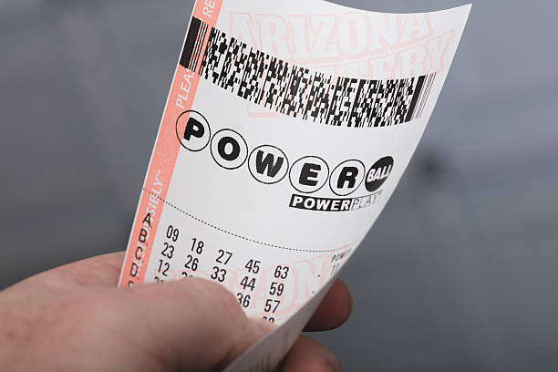 Powerball Kingman, USA - January 20, 2016: A photo of a man holding a Powerball lottery ticket in Kingman, Arizona.  lottery stock pictures, royalty-free photos & images