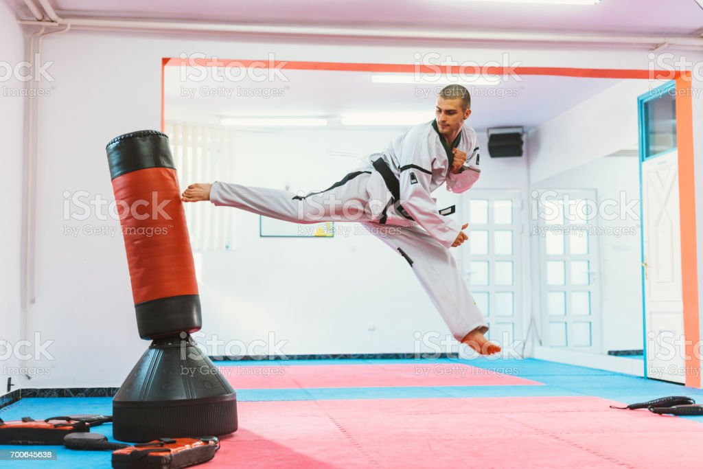 Powerful back kick to the punching bag stock photo