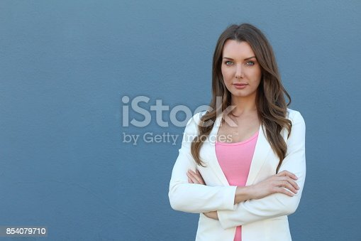 istock Powerful businesswoman isolated on blue 854079710