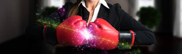 powerful businesswoman with boxing gloves stock photo