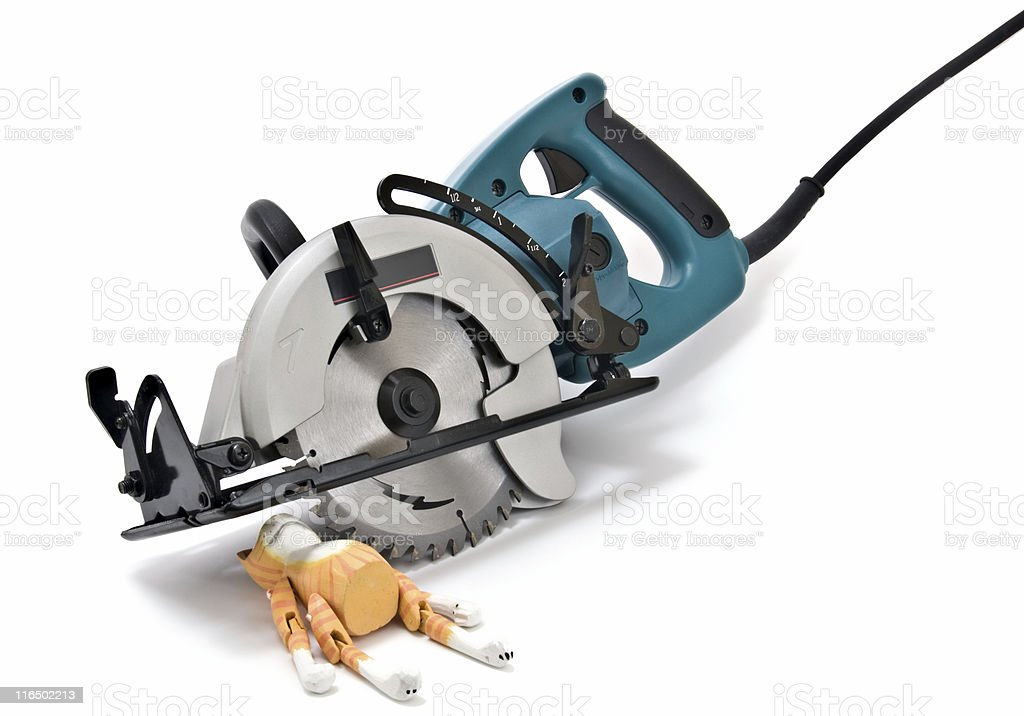 Powerful Circular Saw and Toy Wooden Cat,  Isolated on White stock photo