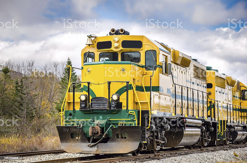 Powerful Diesel Locomotive and Cloudy Sky stock photo