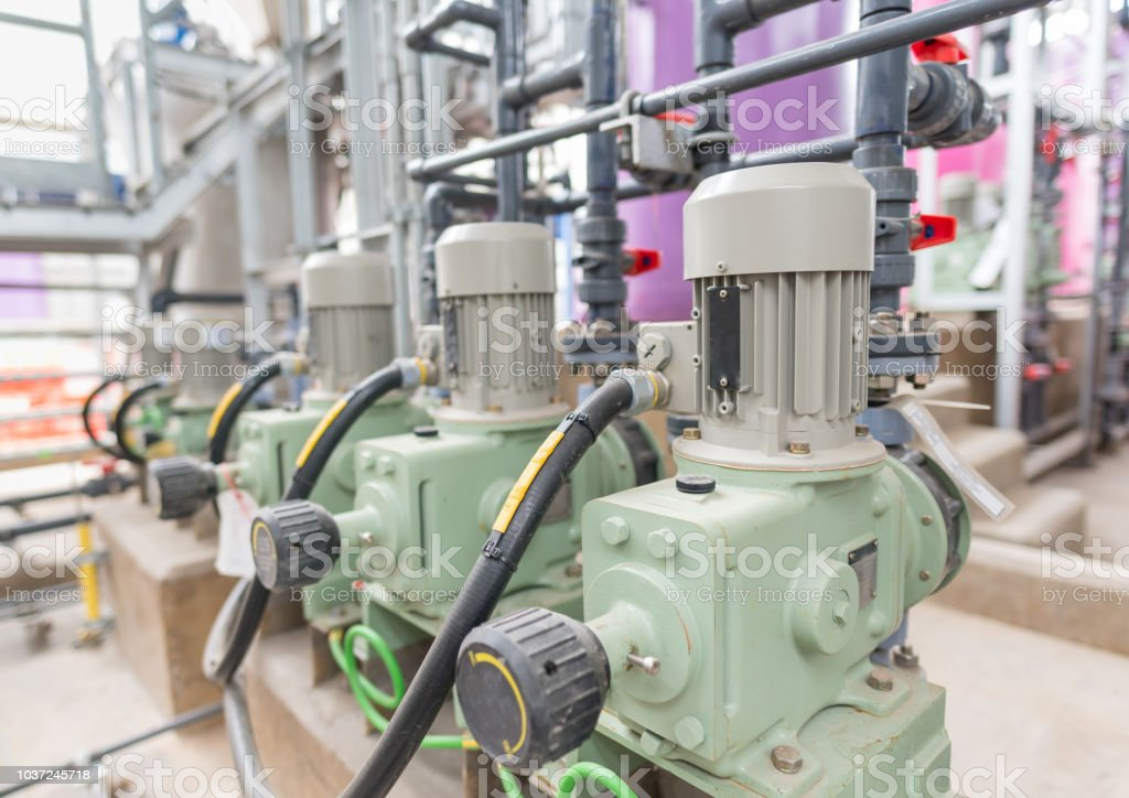 powerful electric motors for modern industrial equipment at factory stock photo