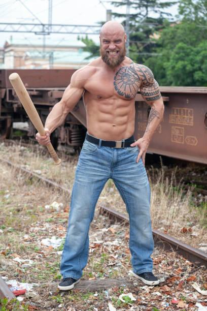 Powerful hooligan with baseball bat stock photo