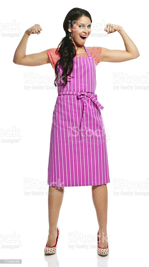 Powerful housewife Full lenght portrait of confident young housewife wearing an apron, showing off her muscles.  20-24 Years Stock Photo